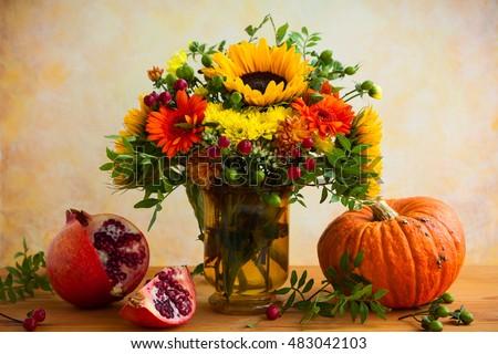 Autumn still life with flowers, pumpkin and fruits #483042103