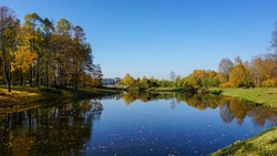 Autumn sunny day on the lake in the park in Pavlovsk.