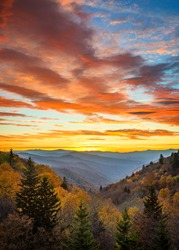 Autumn sunrise and dramatic sky over Oconaluftee overlook in the Smoky Mountains