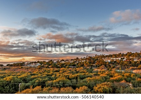 Shutterstock Autumn sunset at Santa Rosa Park estuary Cambria California. In the background you see homes on Happy Hill covered in autumn sunshine.