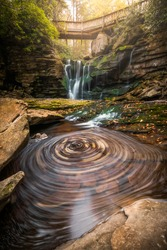 Autumn swirls at Elakala Falls, one of the dreamiest waterfalls in West Virginia.