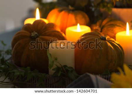 Autumn table setting with candles and pumpkins #142604701