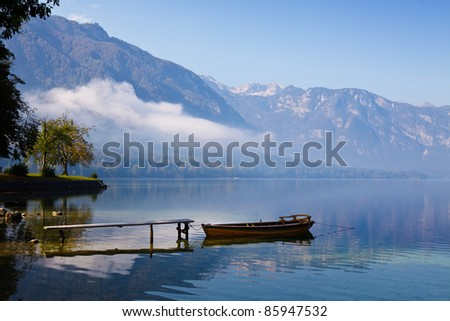Autumn time at lake in valley in Slovenian Alps.