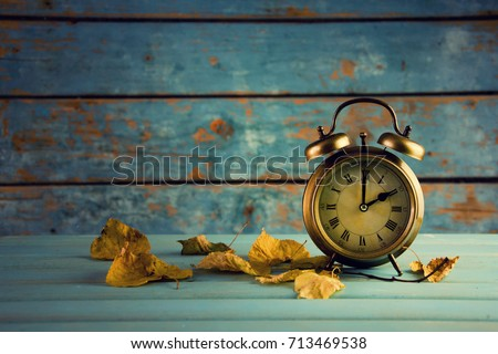 Autumn Time Change, Autumn Leaves and Alarm Clock.