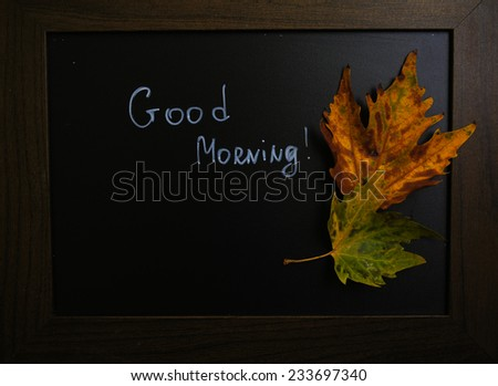Autumn time, yellow autumnal leaves on the chalkboard with note
