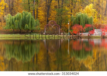 Autumn tints of nature,Park in autumn tints is reflected in silent pond,autumn,autumn winter,fall photo,about autumn,autumn theme,gold autumn,fall pictures,garden in autumn,autumn nature photography - stock photo