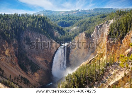 Autumn to Yellowstone national park. The well-known mountain falls, the river and forest