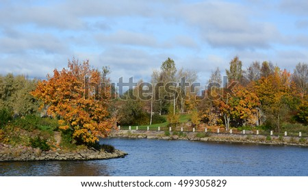 Autumn trees with the lake in Europe. #499305829