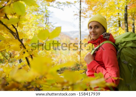 Autumn trek woman on mountain hike