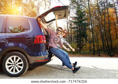 Autumn trip of car and two lovers