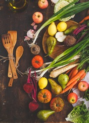 Autumn vegetables and fruit retro meal concept. Wooden spoon and veggies, fruit on old background. Vegetarian food, health or cooking concept. series.