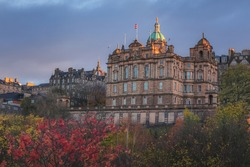 Autumn view at sunset or sunrise from Princes Street Gardens of Museum on the Mound off the Royal Mile in old town Edinburgh housed in the head office for Bank of Scotland.