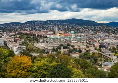 Autumn view from Gellert Hill to Buda Castle and King Palace Budavári Palota of the Hungarian kings on stormy weather Stock fotó ©