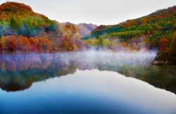 Autumn view of lake and mountain reflections in wedge pond,