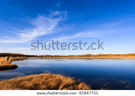 autumn view of the lake and sky reflections in water - stock photo