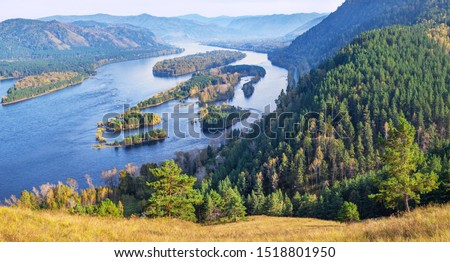 Photo of  Autumn view. The Yenisei River flows through a picturesque valley. Blue water and islands. South of Western Siberia. Travels in Russia and Asia.