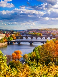 Autumn view to Charles bridge on Vltava river in Prague, Czech Republic. Autumn view to Charles Bridge, Prague old town and Vltava river from popular view point in the Letna park (Letenske sady).