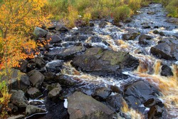 Autumn waterfall at roadside park in the Upper Peninsula of Michigan in early October at Tioga Falls.