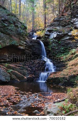 Autumn Waterfall in mountain from Bushkill Falls, Pennsylvania.