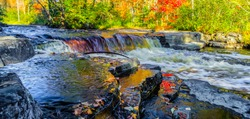 Autumn Waterfall Panorama. Gorgeous Upper Peninsula Michigan waterfall landscape at the Canyon Falls Scenic area between Baraga and Marquette, Michigan.
