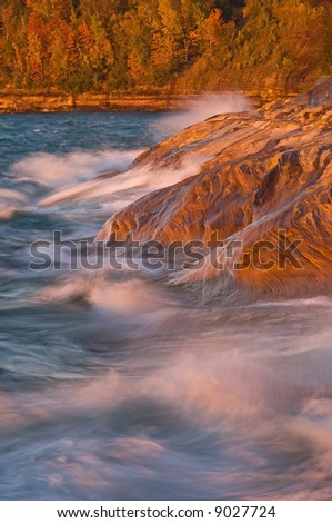 Autumn waves of Lake Superior crash upon the sandstone shore of Pictured Rocks National Lakeshore, Michigan's Upper Peninsula, USA
