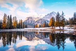 Autumn-winter landscape on Lago Antrno, Dolomites, Italy in pastel colors