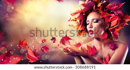 autumn woman blowing red leaves ...
