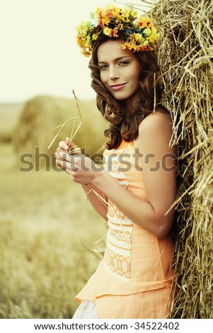 autumn woman close-up portrait with nature on the background