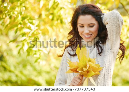 Autumn woman in autumn park. Warm sunny weather. Fall concept #737737543