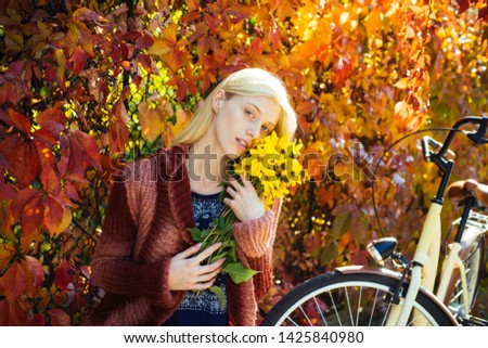 Autumn woman in autumn park with dark red pullover. Beautiful Autumn Woman with Autumn Leaves on Fall Nature Background #1425840980