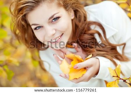 Autumn woman on leafs background #116779261