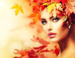 Autumn Woman Portrait. Beauty Fashion Model Girl with Autumnal Make up and Hair style. Fall. Creative Autumn Makeup. Beautiful Face.