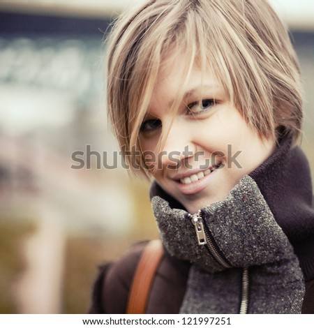 Autumn woman portrait smiling outdoors at the park - stock photo