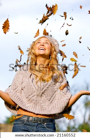 autumn woman smiling and having fun outdoors
