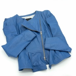 Autumn women's jacket made of soft natural blue leather. Curly cut, with pleats. Slant zipper closure. White lining with dots.Isolated over white background.