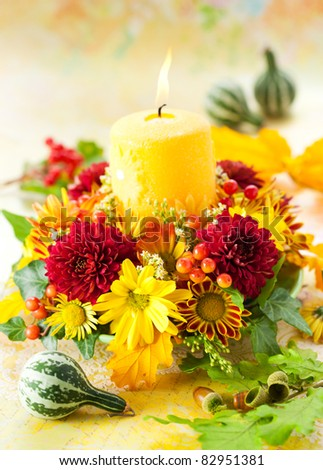 autumn wreath with yellow candle and flowers