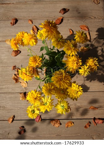 Autumn yellow flowers bouquet with dry leaves