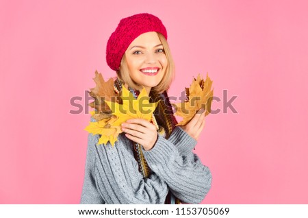 Autumn. Yellow maple leaf. Portrait of smiling woman with maple leaf. Autumn mood. Smiling woman with autumnal leaf. Woman holds leaves in hand. Copy space. Isolated.