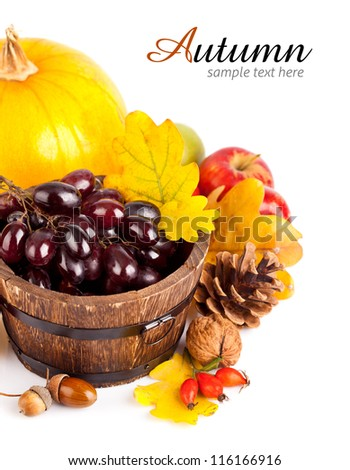autumnal harvest fruits and vegetables with yellow leaves isolated on white background