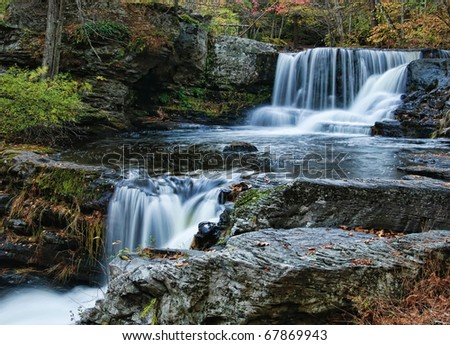 Autumnal Pocono waterfall scene of the upper Factory Falls, located in George W Childs' State Park, Dingmans Ferry, Pennsylvania