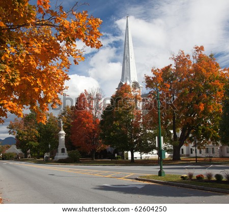 Autumnal shot of the main street of Manchester Vermont in fall as the bright trees turn orange and red