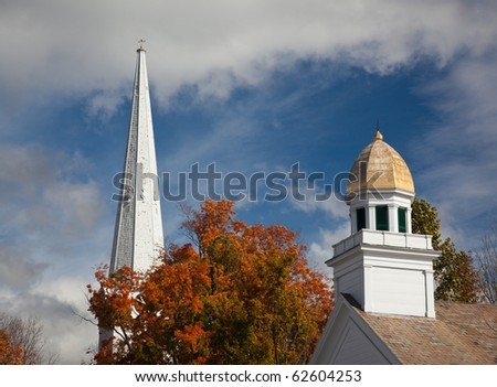 Autumnal shot of the main street of Manchester Vermont in fall as the bright trees turn orange and red - stock photo