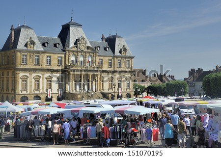 Autun,France-June 07,2013: View at the open air market in Autun,France. This market is held on mornings in front of the city hall at the  place du champ de mars  . June 7,2013 Autun, France