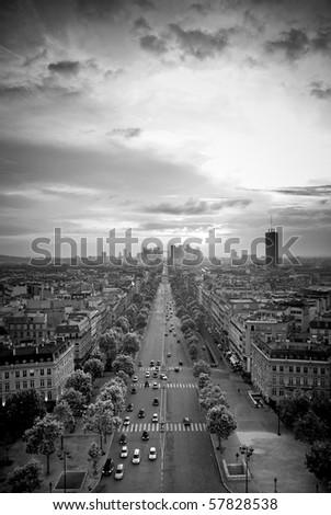 Av. de la Grande Armee, Paris, France. View from the top of the Arc de Triomphe; sunset. - stock photo