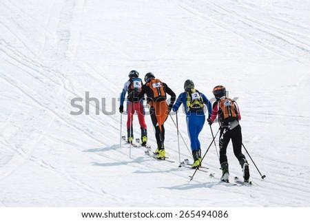 AVACHA, KORYAK VOLCANOES, KAMCHATKA, RUSSIA - APRIL 27, 2014: Two teams of ski mountaineers climb the mountain on skis. Team Race ski mountaineering Asian, ISMF, Russian, Kamchatka Championship.
