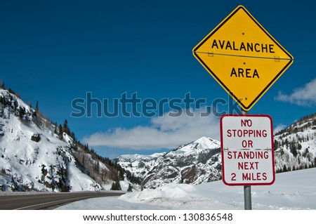 Avalanche Area Sign:  A convertible sign alerts winter travelers to possible snow slides in the Rocky Mountains of southwest Colorado.