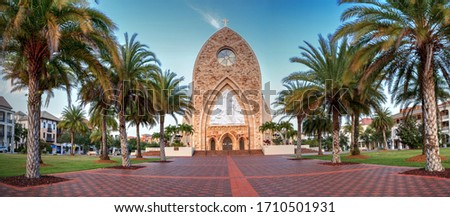 Photo of  Ave Maria, Florida, USA – April 19, 2020: Ave Maria Parish Church on the Ave Maria University campus at sunset in Ave Maria, Florida.