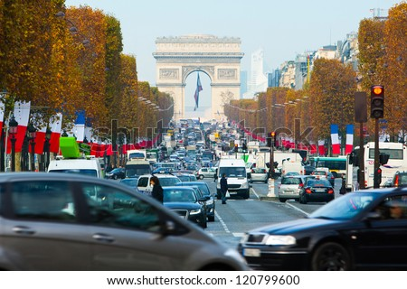 avenue Champs Elysees - one of a famous touristic attractions in Paris - stock photo