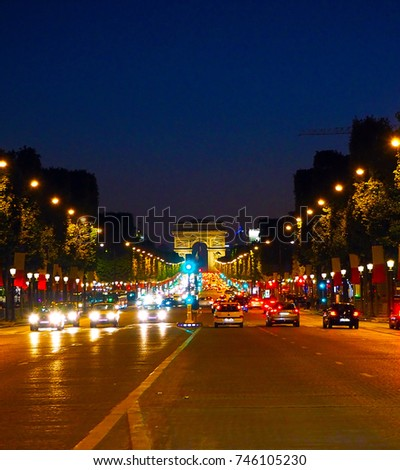 Avenue Champs-Elysees with illumination and triumphal arch on the horizon in Paris, France. Champs Elysees is one of the most famous and famous streets in the world. #746105230