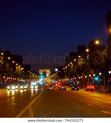 Avenue Champs-Elysees with illumination and triumphal arch on the horizon in Paris, France. Champs Elysees is one of the most famous and famous streets in the world. #746105275